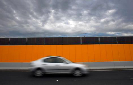 tullamarine interchange, tullamarine solar power, solar power, solar sound barrier, solar power barrier, sound-proof solar panels, noise reduction solar barriers